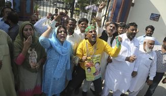Supporters of Pakistani former Prime Minister Nawaz Sharif shout anti-government slogans outside a hospital in Lahore, Pakistan, Tuesday, Oct. 22, 2019. Sharif, who was convicted on corruption charges, has been rushed to hospital from the prison after recent blood tests raised doctors' concerns. (AP Photo/K.M. Chaudary, File