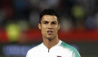 FILE - In this Sept. 7, 2019, file photo, is Portugal's Cristiano Ronaldo prior to playing their Euro 2020 group B qualifying soccer match between Serbia and Portugal, in Belgrade, Serbia. Cristiano Ronaldo's lawyers are asking a U.S. judge to order closed-door arbitration or to dismiss a Nevada woman's lawsuit seeking damages on an accusation the soccer star raped her in Las Vegas in 2009. Attorneys representing Ronaldo's accuser, Kathryn Mayorga, didn't immediately respond Tuesday, Oct. 22, 2019, to messages about two Oct. 14 court filings in the case stemming from a 2010 confidentiality agreement and $375,000 hush-money settlement. (AP Photo/Darko Vojinovic, File)