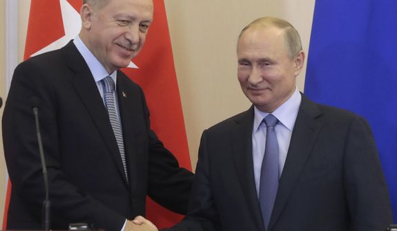 Russian President Vladimir Putin, right, and Turkish President Recep Tayyip Erdogan shake hands after their joint news conference following their talks in the Bocharov Ruchei residence in the Black Sea resort of Sochi, Russia, Tuesday, Oct. 22, 2019. Erdogan says Turkey and Russia have reached a deal in which Syrian Kurdish fighters will move 30 kilometers (18 miles) away from a border area in northeast Syria within 150 hours. (Sergei Chirikov/Pool Photo via AP)