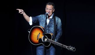 "FILE - In this Nov. 5, 2018 file photo, Bruce Springsteen performs at the 12th annual Stand Up For Heroes benefit concert at the Hulu Theater at Madison Square Garden in New York. Springsteen surprised moviegoers by introducing his new concert film in his New Jersey hometown. The Asbury Park Press reports Springsteen introduced two showings of ""Western Stars"" at the AMC Loews Freehold Metroplex Cinema in Freehold on Saturday, Oct. 19, 2019.  (Photo by Brad Barket/Invision/AP, File)"