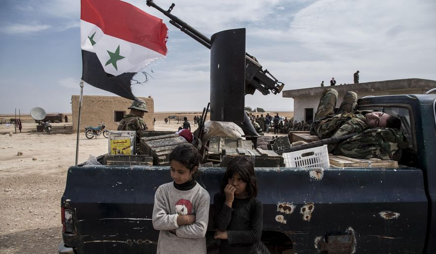 Syrian government forces deploy near the town of Tal Tamr, north Syria, Tuesday, Oct. 22, 2019. Russia and Turkey announced an agreement Tuesday to jointly patrol almost the entire northeastern Syrian border after the withdrawal of Kurdish fighters, cementing the two countries' power in Syria in the wake of President Donald Trump's abrupt withdrawal of U.S. forces. (AP Photo/Baderkhan Ahmad)