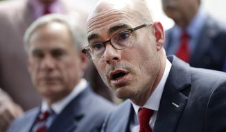 """FILE - In this May 23, 2019, file photo, Texas House Speaker Dennis Bonnen, right, with Governor Greg Abbott, left, speaks at a news conference at the Texas Governor's Mansion in Austin, Texas. Bonnen said  in a statement Tuesday, Oct. 22, 2019 he will not run for re-election, making the announcement less than a week after the release of a secretly recorded conversation in which Bonnen sought help ousting members of his own party in 2020 and called a female lawmaker """"vile."""" (AP Photo/Eric Gay, File)"""