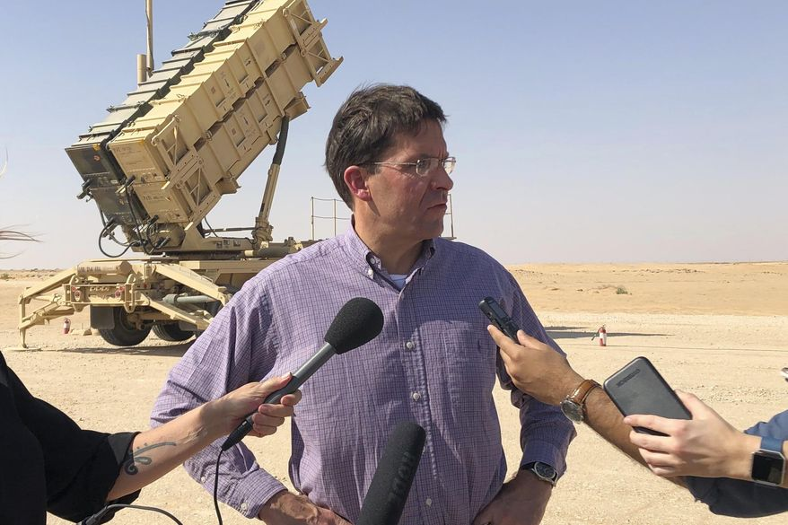 Defense Secretary Mark Esper talks to reporters at Prince Sultan Air Base in Saudi Arabia, Tuesday, Oct. 22, 2019, where he saw a Patriot missile battery that the U.S. sent to Saudi to help protect the kingdom against the Iranian threat. (AP Photo/Lolita Baldor)