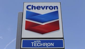 FILE - This Tuesday, May 2, 2017 file photo, shows a Chevron sign at a gas station in Miami. The Trump administration said Tuesday, Oct. 22, 2019, that it is allowing Chevron to continue operating in Venezuela at least until Jan. 22, 2020, despite sanctions aimed at forcing President Nicolas Maduro from power by choking off income and investment for his government. (AP Photo/Alan Diaz, File)