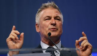 """In this Monday, Nov. 27, 2017, file photo, actor Alec Baldwin speaks during the Iowa Democratic Party's fall gala, in Des Moines, Iowa. Baldwin, known for his mocking impersonations of President Donald Trump on """"Saturday Night Live"""" is coming to Virginia to help Democratic legislative candidates. Baldwin is set to knock on doors, make calls and deliver pizza to volunteers at multiple stops around Virginia on Tuesday, Oct. 22, 2019. (AP Photo/Charlie Neibergall, File)"""