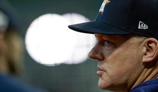 Houston Astros manager AJ Hinch watches during batting practice for Game 1 of the baseball World Series against the Washington Nationals Tuesday, Oct. 22, 2019, in Houston. (AP Photo/David J. Phillip) ** FILE **