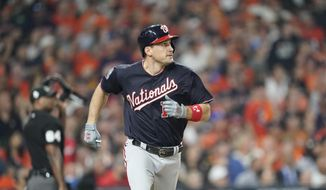 Washington Nationals' Ryan Zimmerman hits a home run during the second inning of Game 1 of the baseball World Series against the Houston Astros Tuesday, Oct. 22, 2019, in Houston. (AP Photo/David J. Phillip) ** FILE **