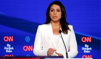 Democratic presidential candidate Rep. Tulsi Gabbard, D-Hawaii, speaks during a Democratic presidential primary debate hosted by CNN/New York Times at Otterbein University, Tuesday, Oct. 15, 2019, in Westerville, Ohio. (AP Photo/John Minchillo)