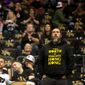 A fan wears a T-shirt handed out by Hong Kong pro-democracy supporters at the season opener between the Pelicans and the Raptors in Toronto on Tuesday. (ASSOCIATED PRESS)