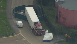 An aerial view as police forensic officers attend the scene after a truck was found to contain a large number of dead bodies, in Thurock, South England, early Wednesday Oct. 23, 2019. Police in southeastern England said that 39 people were found dead Wednesday inside a truck container believed to have come from Bulgaria. (UK Pool via AP)