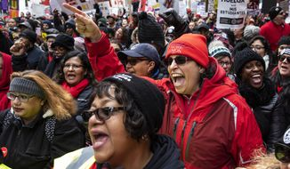 Thousands of striking Chicago Teachers Union and  their supporters rally at the Thompson Center after marching at City Hall during Mayor Lori Lightfoot's first budget address during the monthly Chicago City Council meeting, Wednesday, Oct. 23, 2019.  Classes at Chicago Public Schools were canceled for the fifth day on Wednesday as the Chicago Teachers Union and the district remained at odds over teacher pay, class sizes and additional staff for schools. (Ashlee Rezin Garcia/Chicago Sun-Times via AP)