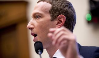 Facebook CEO Mark Zuckerberg testifies before a House Financial Services Committee hearing on Capitol Hill in Washington, Wednesday, Oct. 23, 2019, on Facebook's impact on the financial services and housing sectors. (AP Photo/Andrew Harnik) ** FILE **