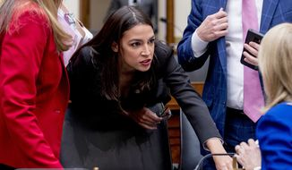 Rep. Alexandria Ocasio-Cortez, D-N.Y., speaks with other lawmakers during a break from testimony from Facebook CEO Mark Zuckerberg before a House Financial Services Committee hearing on Capitol Hill in Washington, Wednesday, Oct. 23, 2019, on Facebook's impact on the financial services and housing sectors. (AP Photo/Andrew Harnik)