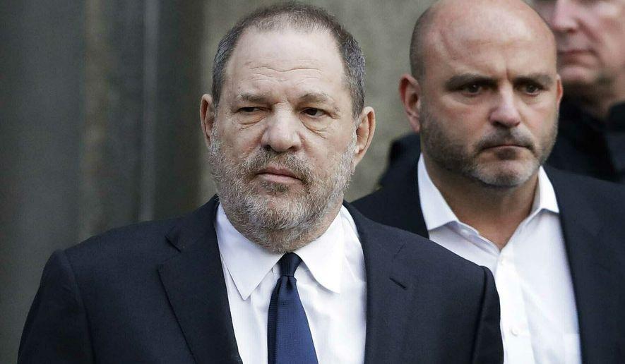 In this Thursday, Dec. 20, 2018, file photo, Harvey Weinstein, center, leaves New York Supreme Court in New York.  (AP Photo/Mark Lennihan, File)  **FILE**