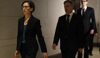 Deputy Assistant Secretary of Defense Laura Cooper, left, arrives for a closed door meeting to testify as part of the House impeachment inquiry into President Donald Trump, Wednesday, Oct. 23, 2019, on Capitol Hill in Washington. (AP Photo/Patrick Semansky)