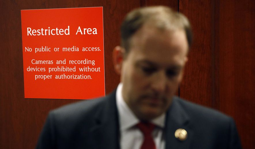 A sign marks a door to a secure area behind Rep. Lee Zeldin, R-N.Y., as he speaks with members of the media after Deputy Assistant Secretary of Defense Laura Cooper arrived for a closed door meeting to testify as part of the House impeachment inquiry into President Donald Trump, Wednesday, Oct. 23, 2019, in Washington. (AP Photo/Patrick Semansky)