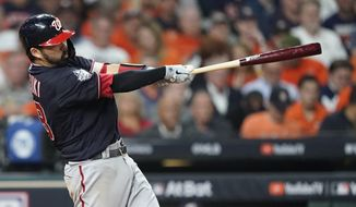 Washington Nationals' Kurt Suzuki hits a home run during the seventh inning of Game 2 of the baseball World Series against the Houston Astros Wednesday, Oct. 23, 2019, in Houston. (AP Photo/David J. Phillip) ** FILE **