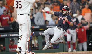 Washington Nationals' Adam Eaton scores on a double by Anthony Rendon during the first inning of Game 2 of the baseball World Series against the Houston Astros Wednesday, Oct. 23, 2019, in Houston. (AP Photo/David J. Phillip) **FILE**