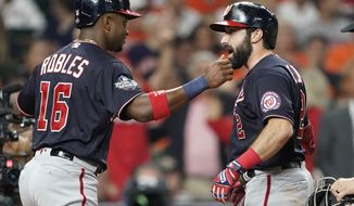 Washington Nationals' Adam Eaton is congratulated by Victor Robles after hitting a two-run home run during the eighth inning of Game 2 of the baseball World Series against the Houston Astros Wednesday, Oct. 23, 2019, in Houston. (AP Photo/David J. Phillip) ** FILE **
