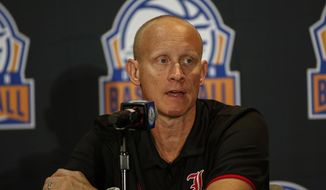 Louisville coach Chris Mack answers a question during the Atlantic Coast Conference NCAA college basketball media day in Charlotte, N.C., Tuesday, Oct. 8, 2019. (AP Photo/Nell Redmond)