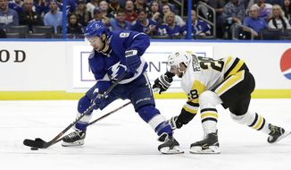 Tampa Bay Lightning center Tyler Johnson (9) works his way around Pittsburgh Penguins defenseman Marcus Pettersson (28) during the second period of an NHL hockey game Wednesday, Oct. 23, 2019, in Tampa, Fla. (AP Photo/Chris O'Meara)