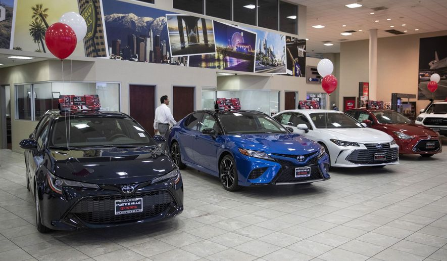 FILE - In this Feb. 14, 2019, file photo, Toyota sedans are displayed in a showroom at Puente Hills Toyota in Industry, Calif. Plenty of car shoppers dedicate hours researching prices to save money. But a large percentage of these shoppers would likely be better served by spending more time researching the vehicle itself. (AP Photo/Jae C. Hong, File)