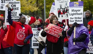Striking Chicago Teachers Union and SEIU Local 73 members rally on the picket line outside Oscar DePriest Elementary School on the West Side, Tuesday, Oct. 22, 2019. (Ashlee Rezin Garcia/Chicago Sun-Times via AP)