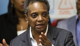 FILE - In this Monday, Oct. 21, 2019, file photo, on the fifth day of the Chicago Teachers Union strike, Mayor Lori Lightfoot speaks to reporters after visiting Chicago Public Schools students at a contingency site, James R. Jordan Boys & Girls Club in Chicago. Lightfoot is expected to detail how the nation's third-largest city should deal with an $838 million budget deficit when she delivers her budget address to the City Council. Lightfoot's speech set for Wednesday morning, Oct. 23, comes on the fifth day of canceled classes during a strike by Chicago Public Schools teachers. (Ashlee Rezin Garcia/Chicago Sun-Times via AP, File)
