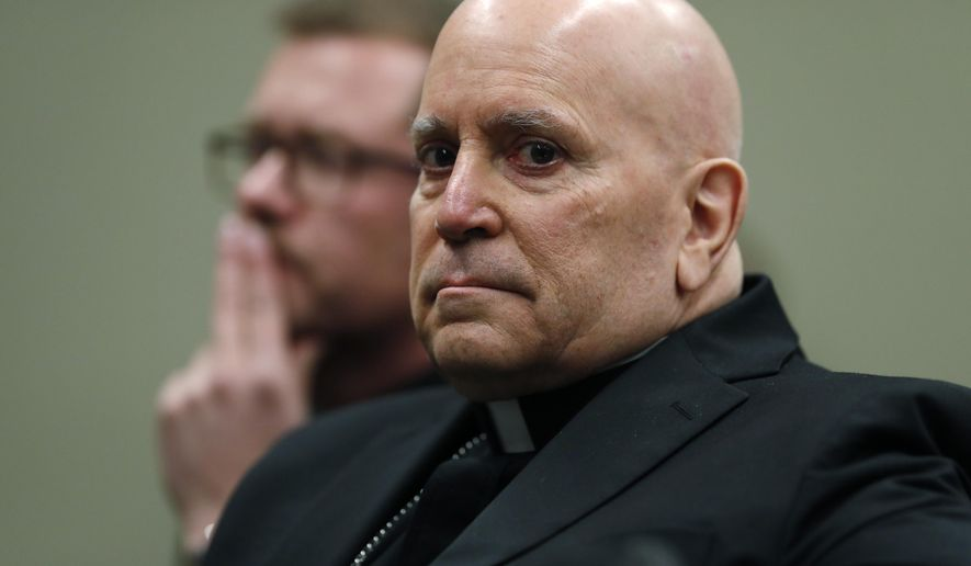 In this Tuesday, Feb. 19, 2019, file photograph, Samuel Aquila, archbishop of the Denver diocese of the Roman Catholic Church, front, looks on with Very Rev. Randy Dollins, vicar general, as a plan is outlined to have a former federal prosecutor review the sexual abuse files of Colorado's Roman Catholic dioceses at a news conference in Denver. On Wednesday, Oct. 23, 2019, a report was released that shows at least 166 children have been sexually abused by Catholic priests in Colorado since 1950. (AP Photo/David Zalubowski, File)