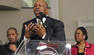 """FILE - In this Sunday, March 30, 2003 file photo, Congressional Black Caucus Chairman Rep. Elijah Cummings, D-Md., speaks about affirmative action, accompanied by Rep. John Conyers, D-Mich., left, and Rep. Sheila Jackson Lee, D-Texas, right, during a church service at Community of Faith Church in Houston. """"Although Congressman Cummings was not a preacher in the sense of being ordained and licensed, him being a preacher's kid made him pretty close and made him very comfortable with ministers and clergy _ to a point where in many respects many of us in the clergy community, in the African-American community, almost regarded him as a preacher,"""" said the Rev. Charles Williams II, senior pastor of Detroit's Historic King Solomon Missionary Baptist Church. (AP Photo/Michael Stravato)"""