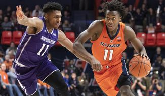 File- This March 3, 2019, file photo shows Illinois guard Ayo Dosunmu (11) driving to the basket against Northwestern guard Anthony Gaines (11) during the first half of an NCAA college basketball game in Champaign, Ill. Illinois is built around highly touted 6-foot-5 sophomore guard/forward  Dosunmu, who averaged 13.8 points per game last season. Dosunmu flirted with the NBA draft last season but returned to Illinois to lead a team known for its swarming defense and ability to score points in a hurry. (AP Photo/Stephen Haas, File)