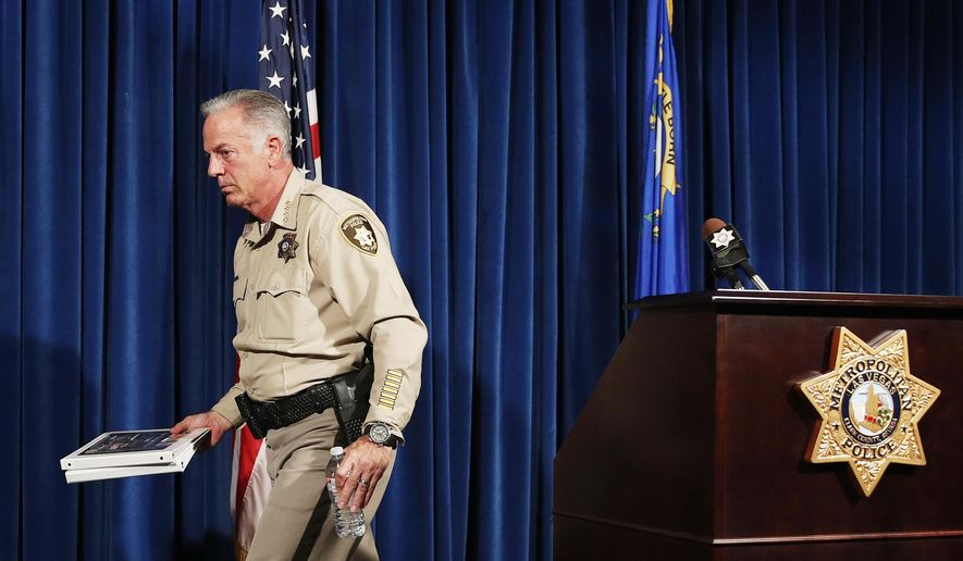 File - In this Aug. 3, 2018, file photo, Clark County Sheriff Joe Lombardo leaves after speaking at a news conference in Las Vegas. Police in Las Vegas are suspending a program letting local jailers detain immigrants at the request of federal authorities even though Nevada doesn't have a law authorizing civil immigration arrests. Clark County Sheriff Joe Lombardo announced the change Wednesday, Oct. 23, 2019, in what's known as the 287(g) program. (AP Photo/John Locher, File)