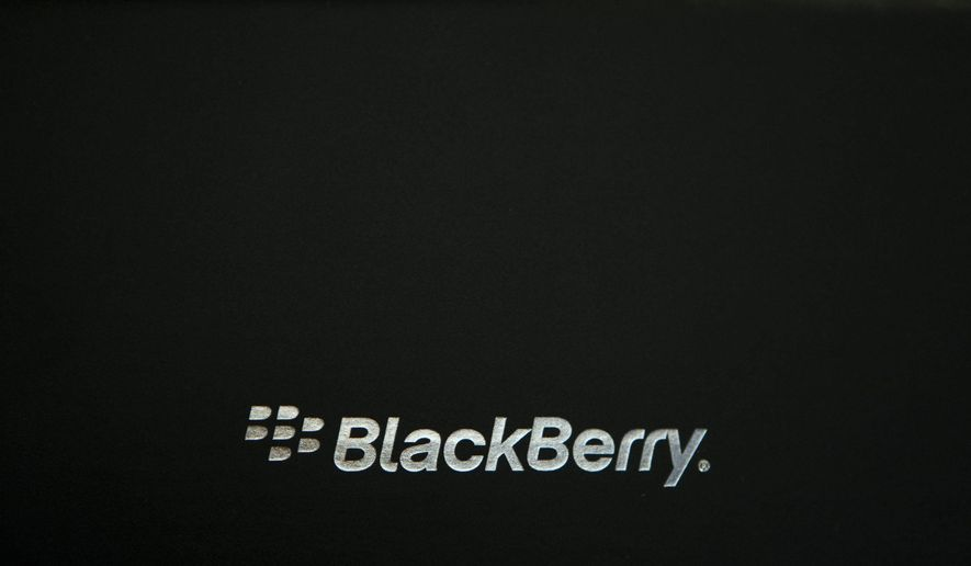 FILE - This Wednesday Oct. 12, 2011, file photo, shows the Blackberry logo on a box in Ottawa, Canada. A report Wednesday, Oct. 23, 2019, by Canadian company Blackberry identifies new espionage campaigns attempting to steal sensitive data from mobile devices. (Adrian Wyld/The Canadian Press via AP, File)