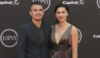 FILE - In this July 18, 2018, file photo, LA Galaxy's Servando Carrasco, left, and U.S. women's national soccer team player Alex Morgan arrive at the ESPY Awards at Microsoft Theater in Los Angeles. The couple are expecting their first child, according to an announcement Wednesday, Oct. 23, 2019, on social media. (Photo by Willy Sanjuan/Invision/AP, File)