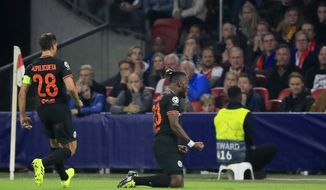 Chelsea's Michy Batshuayi, center, celebrates after scoring his side's opening goal during the group H Champions League soccer match between Ajax and Chelsea at the Johan Cruyff ArenA in Amsterdam, Netherlands, Wednesday, Oct. 23, 2019. (AP Photo/Peter Dejong)