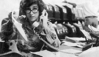 FILE - In this file photo from the late 1970's Kathryn Johnson works at The Associated Press' bureau in Atlanta. Johnson, a trailblazing reporter for the AP, died Wednesday, Oct. 23, 2019, at the age of 93,  in Atlanta. Her intrepid coverage of the civil rights movement and other major stories led to a string of legendary scoops.  Johnson was the only journalist allowed inside Martin Luther King Jr.'s home the day he was assassinated. (AP Photo)