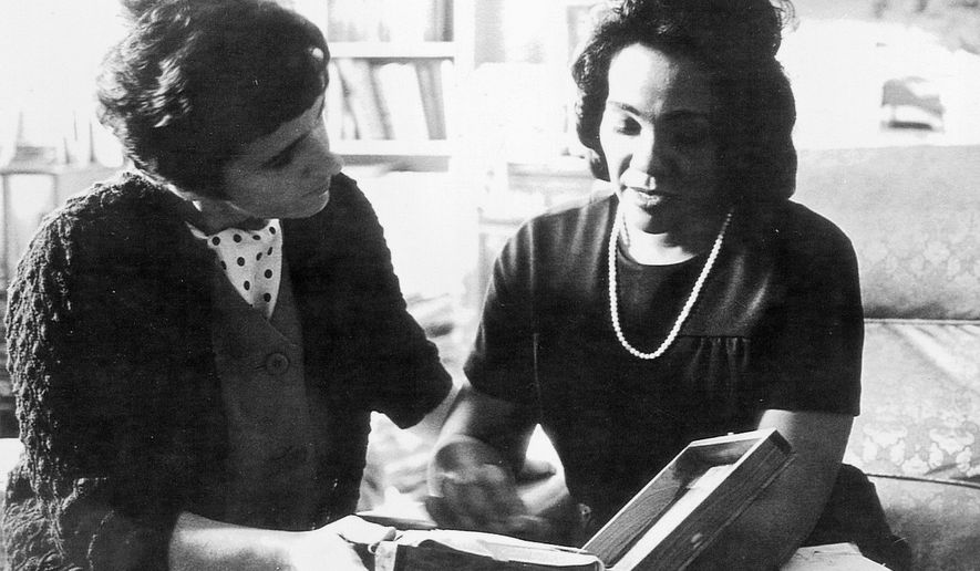 FILE - In this 1968 file photo, Coretta Scott King and Associated Press reporter Kathryn Johnson, left, review plans for The King Center during a meeting on the campus of Atlanta University in Atlanta.  Johnson, a trailblazing reporter for The Associated Press, died Wednesday, Oct. 23, 2019, at the age of 93, in Atlanta. Her intrepid coverage of the civil rights movement and other major stories led to a string of legendary scoops.  Johnson was the only journalist allowed inside Martin Luther King Jr.'s home the day he was assassinated.  (AP Photo, File)