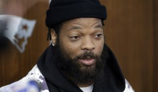 New England Patriots defensive lineman Michael Bennett speaks with members of the media in the team's locker room following NFL football practice, Wednesday, Oct. 23, 2019, in Foxborough, Mass. (AP Photo/Steven Senne)