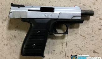 This photo provided by the New York Police Department shows a firearm recovered at the scene where police shot and killed a suspect early Wednesday, Oct. 23, 2019, in New York. A police officer, also shot during the incident, was in stable condition and is expected to survive. He was shot in the chest but was wearing a bullet-proof vest. (New York Police Department via AP)