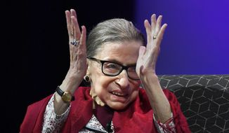 In this Oct. 3, 2019, file photo, U.S. Supreme Court Justice Ruth Bader Ginsburg claps after listening to students sing opera at Amherst College in Amherst, Mass. (AP Photo/Jessica Hill)