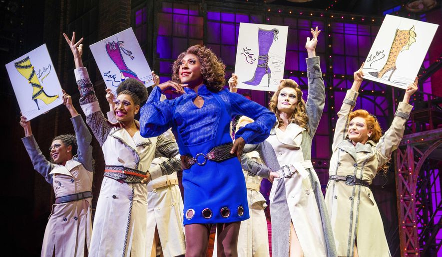 """This image released by BroadwayHD shows Matt Henry as Lola, center, in the London production of """"Kinky Boots."""" While opera has long made it to TV, media companies like Netflix, Fanthom Events, Audible Inc. and BroadwayHD are reshaping what theater can be, evolving it past the quaint notion of patrons filing into an arena, turning off their phones and sitting quietly in the dark.  (Matt Crockett/BroadwayHD via AP)"""