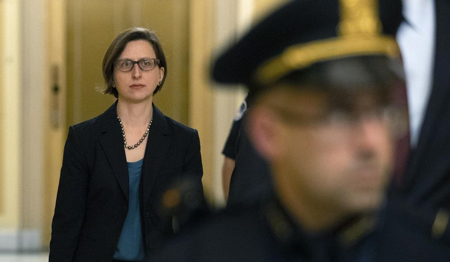 Deputy Assistant Secretary of Defense Laura Cooper arrives for a closed door meeting to testify as part of the House impeachment inquiry into President Donald Trump, Wednesday, Oct. 23, 2019, on Capitol Hill in Washington. (AP Photo/Patrick Semansky)
