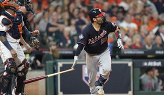Washington Nationals' Kurt Suzuki hits a home run during the seventh inning of Game 2 of the baseball World Series against the Houston Astros Wednesday, Oct. 23, 2019, in Houston. (AP Photo/David J. Phillip)