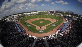 In this Feb. 28. 2017, file photo, theWashington Nationals and the Houston Astros play a spring training baseball game at Ballpark of the Palm Beaches in West Palm Beach, Fla. The game was the first to be played in the new stadium, which serves as both clubs' spring training home. The Houston-Washington World Series, which began Tuesday, is the first in the modern era to feature teams that share a common spring training site. In 1942, the Cardinals and Yankees met in the Series after playing their spring games in the same St. Petersburg, Fla., ballpark but training at different sites. (AP Photo/John Bazemore, File) **FILE**