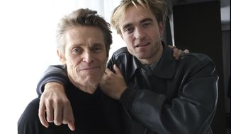 """This Sept. 7, 2019 photo shows Willem Dafoe, left, and Robert Pattinson posing together to promote their film, """"The Lighthouse,"""" at the Thompson Hotel during the Toronto International Film Festival in Toronto. (Photo by Chris Pizzello/Invision/AP)"""