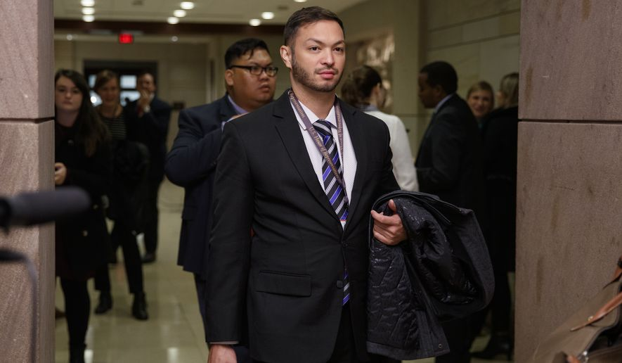 Rep.-elect Michael San Nicolas, D-Guam, walks from member-elect briefings on Capitol Hill in Washington, Thursday, Nov. 15, 2018. (AP Photo/Carolyn Kaster)