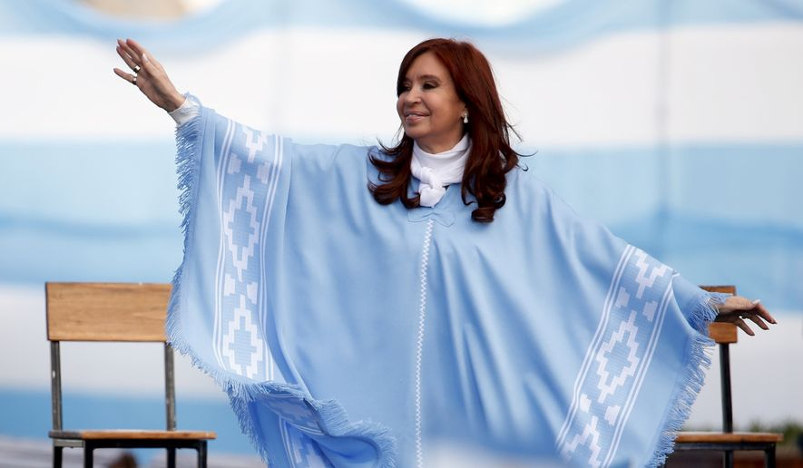Vice Presidential candidate Cristina Fernandez de Kirchner waves to supporters upon her arrival to a closing campaign rally with running mate Alberto Fernandez in Mar Del Plata, Argentina, Thursday, Oct. 24, 2019.  Argentina will hold presidential elections on  Oct. 27.  (AP Photo/Natacha Pisarenko)
