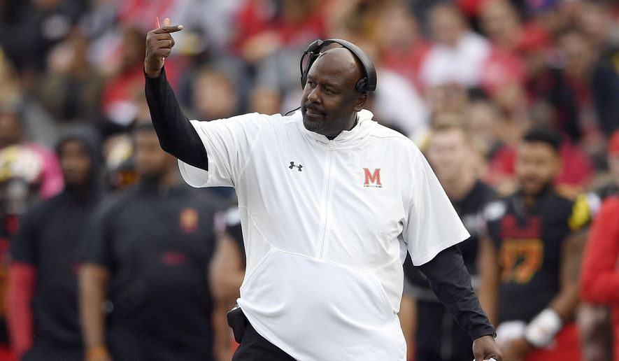In this Saturday, Oct. 19, 2019, file photo, Maryland head coach Mike Locksley gestures during the first half of an NCAA football game against Indiana in College Park, Md. In his first year at Maryland, Locksley has formed a close rapport with his players. Although the Terrapins (3-4, 1-3) have dropped four of five and appeared destined for a fourth consecutive losing season, no one has asked for a redshirt. (AP Photo/Nick Wass, File) **FILE**