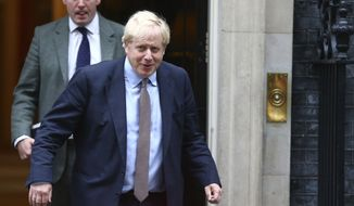 Britain's Prime Minister Boris Johnson leaves 10 Downing Street, on his way to parliament in London, Thursday Oct. 24, 2019.  In a TV interview Thursday Johnson has announced that he will offer lawmakers more time to scrutinize his Brexit legislation, but only if parliament agree for a General Election on December 12. (Hollie Adams/PA via AP)