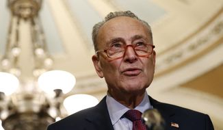 In this Oct. 22, 2019, file photo, Senate Minority Leader Sen. Chuck Schumer of N.Y., speaks to members of the media following a Senate policy luncheon on Capitol Hill in Washington. (AP Photo/Patrick Semansky) ** FILE **